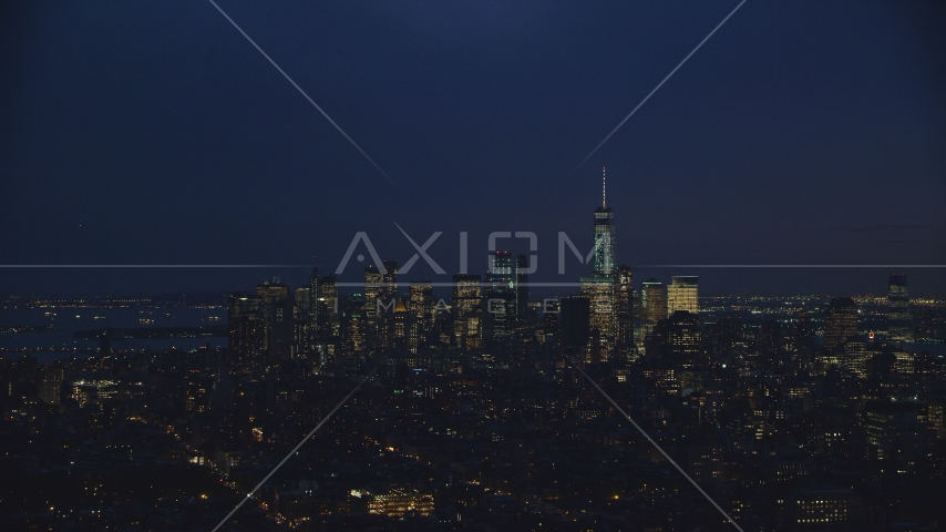 The Lower Manhattan skyline at night in New York City Aerial Stock Photos | AX121_153.0000127F