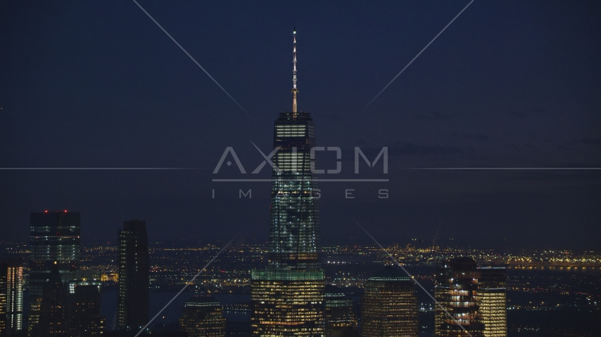 Top of One World Trade Center at night in Lower Manhattan, New York City Aerial Stock Photos AX121_157.0000058F
