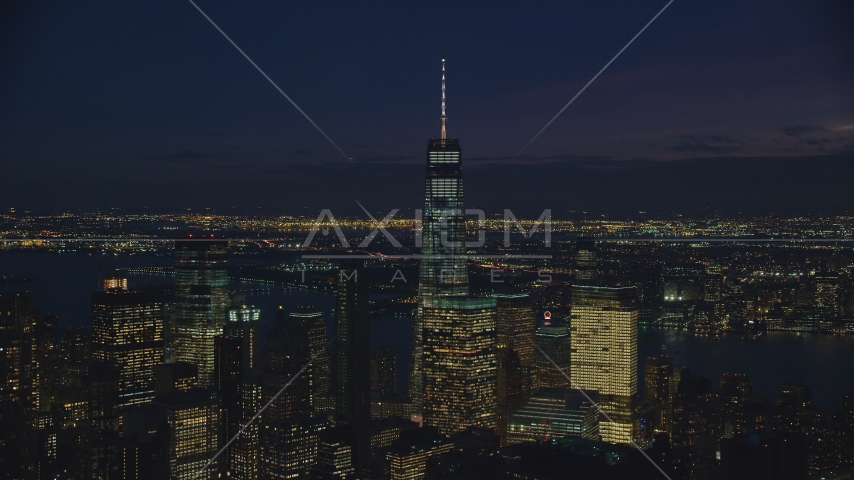 Freedom Tower and downtown skyscrapers in Lower Manhattan at night, New York City Aerial Stock Photos | AX121_159.0000261F