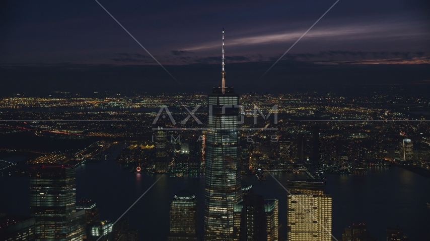 Freedom Tower rising above Lower Manhattan at night in New York City Aerial Stock Photos AX121_161.0000259F | Axiom Images