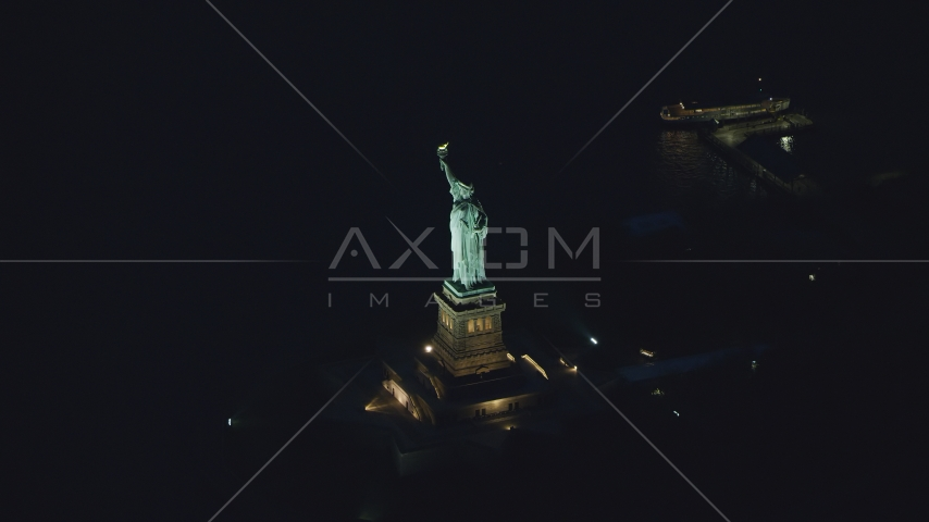 The Statue of Liberty at night in New York Aerial Stock Photos | AX121_167.0000184F