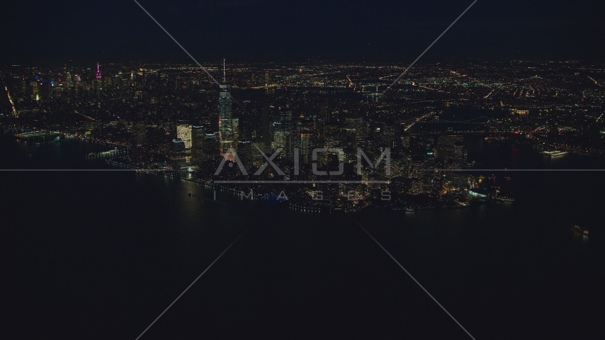 Lower Manhattan at night, New York City, seen from New York Harbor Aerial Stock Photos | AX121_171.0000102F