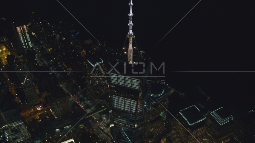 The One World Trade Center spire at night in Lower Manhattan, New York City Aerial Stock Photos | AX121_176.0000088F