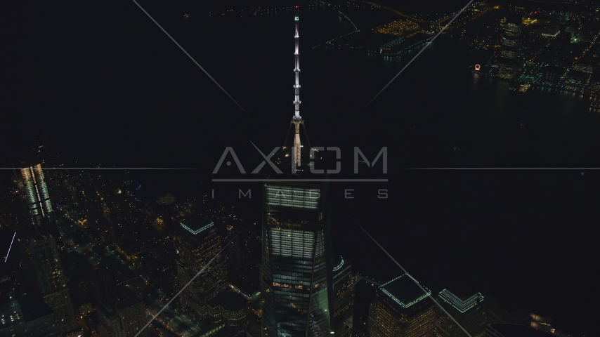 The spire on top of Freedom Tower at night in Lower Manhattan, New York City Aerial Stock Photos | AX121_180.0000105F