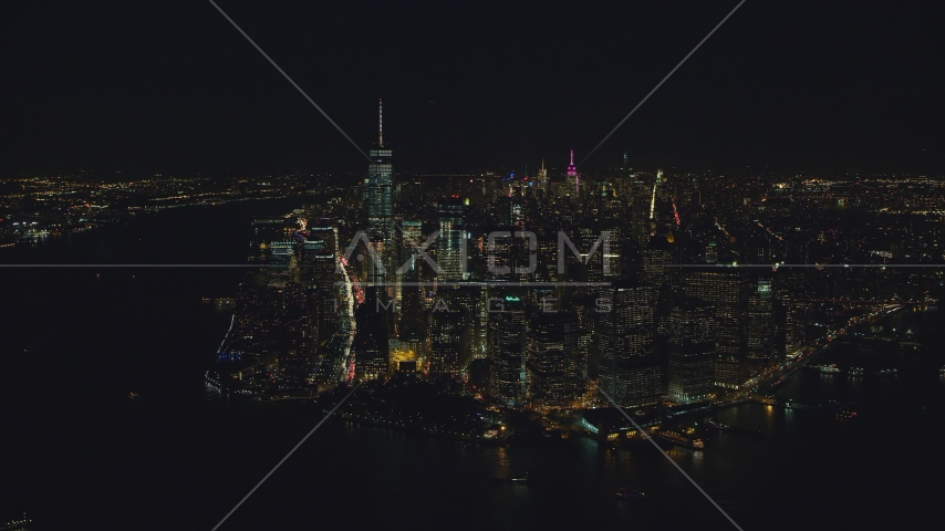Lower Manhattan skyscrapers at night in New York City Aerial Stock Photos | AX121_193.0000103F