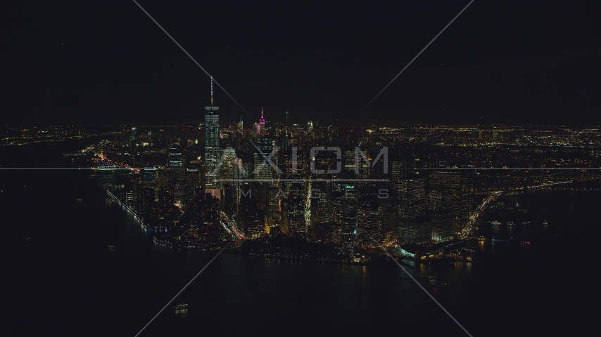 Lower Manhattan at night, seen from New York Harbor in New York City Aerial Stock Photos | AX121_194.0000066F
