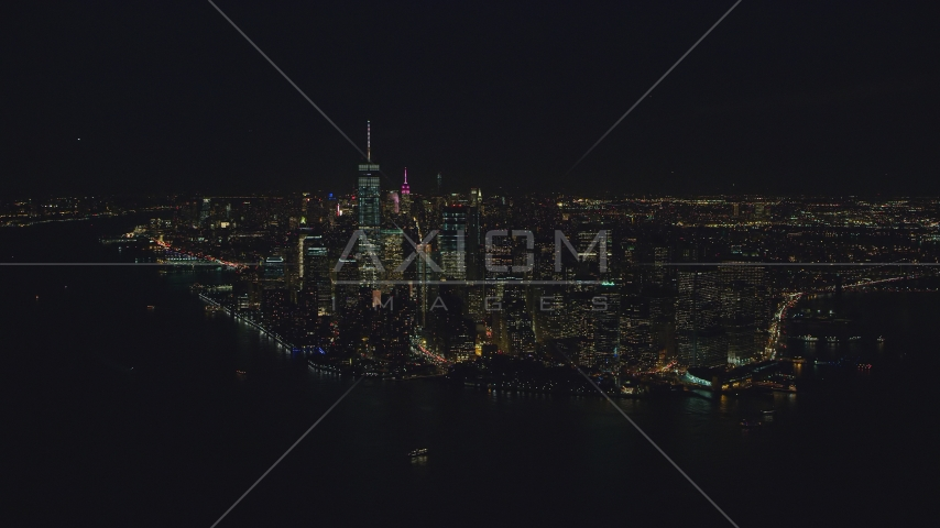 Lower Manhattan seen from New York Harbor at night in New York City Aerial Stock Photos AX121_194.0000179F | Axiom Images