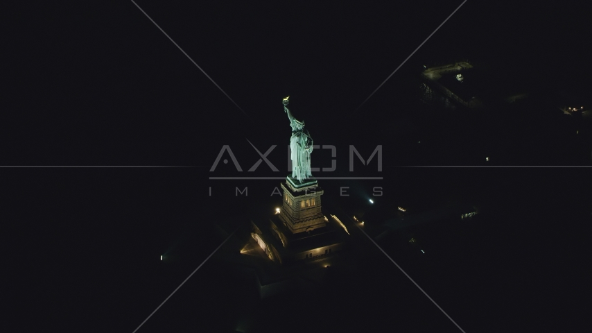 The Statue of Liberty at night, New York Aerial Stock Photos | AX121_195.0000063F