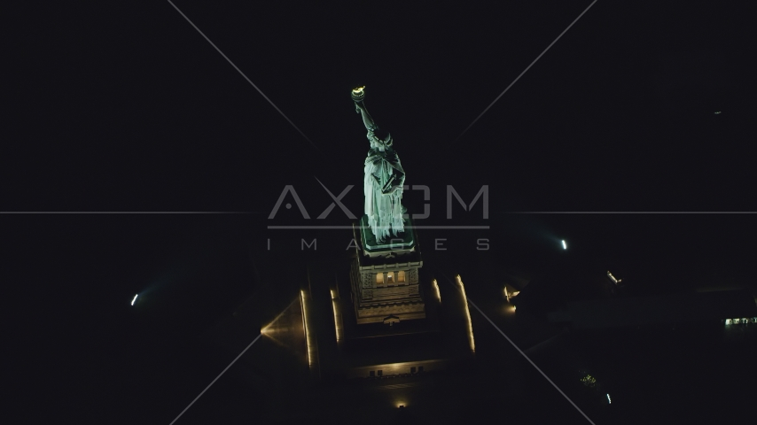 The side of the Statue of Liberty at night in New York Aerial Stock Photos | AX121_195.0000229F