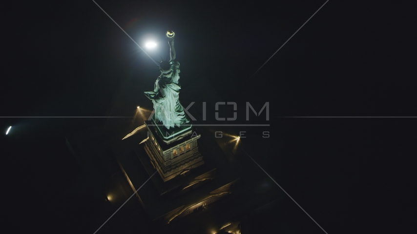 A bird's eye view of the back of the Statue of Liberty at night in New York Aerial Stock Photos | AX121_196.0000108F
