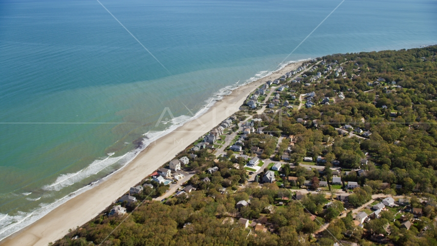 A small town with beachfront homes by Cape Cod Bay, Plymouth, Massachusetts Aerial Stock Photos | AX143_122.0000000