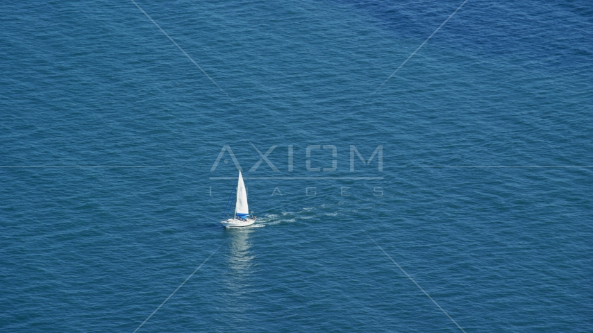 A sailing boat on Cape Cod Bay, Massachusetts Aerial Stock Photos | AX143_125.0000000