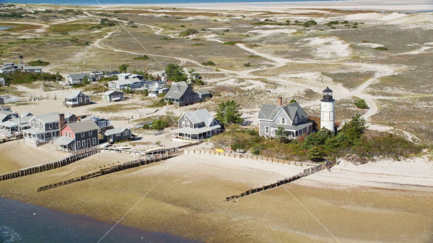 Sandy Neck Colony homes beside Sandy Neck Light, Cape Cod, Barnstable, Massachusetts Aerial Stock Photo AX143_145.0000000 | Axiom Images