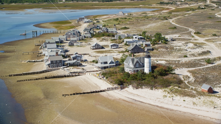 Beachfront houses at Sandy Neck Colony by Sandy Neck Light, Cape Cod, Barnstable, Massachusetts Aerial Stock Photo AX143_145.0000207 | Axiom Images