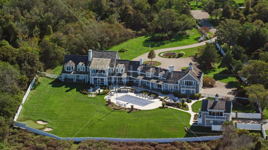 A spacious mansion with green lawns on Cape Cod, Dennis, Massachusetts Aerial Stock Photos | AX143_167.0000143