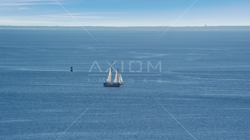 A sailing boat in Cape Cod Bay, Massachusetts Aerial Stock Photos | AX143_220.0000000
