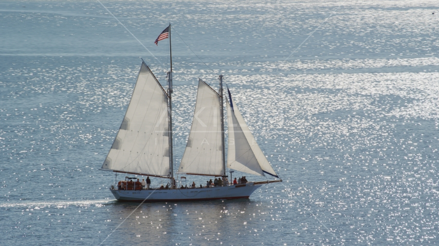 A sailing boat with a crowd of people on Cape Cod Bay, Massachusetts Aerial Stock Photos | AX143_243.0000106