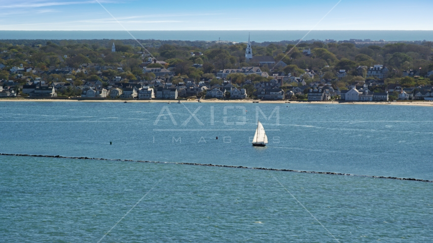 A small island town, sailboats on water, Nantucket, Massachusetts Aerial Stock Photos | AX144_074.0000000