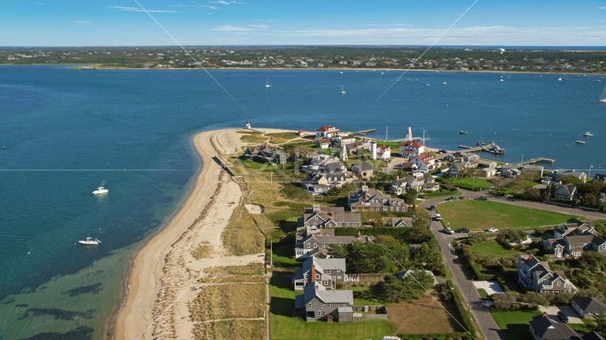 Oceanfront homes and Nantucket Harbor Lights, Nantucket, Massachusetts Aerial Stock Photo AX144_088.0000000 | Axiom Images