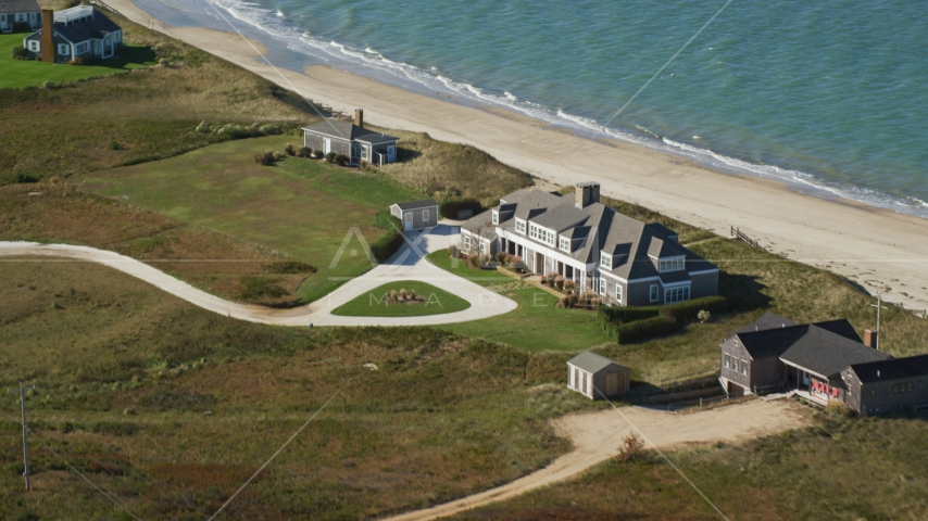 An upscale home by the beach in Nantucket, Massachusetts Aerial Stock Photos | AX144_111.0000000
