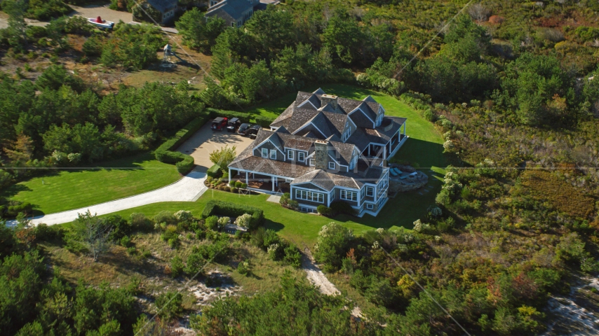 An upscale home and green trees, Nantucket, Massachusetts Aerial Stock Photos | AX144_114.0000020