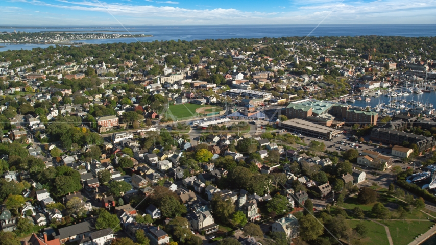 A baseball field surrounded by the coastal community of Newport, Rhode Island Aerial Stock Photos | AX144_230.0000305