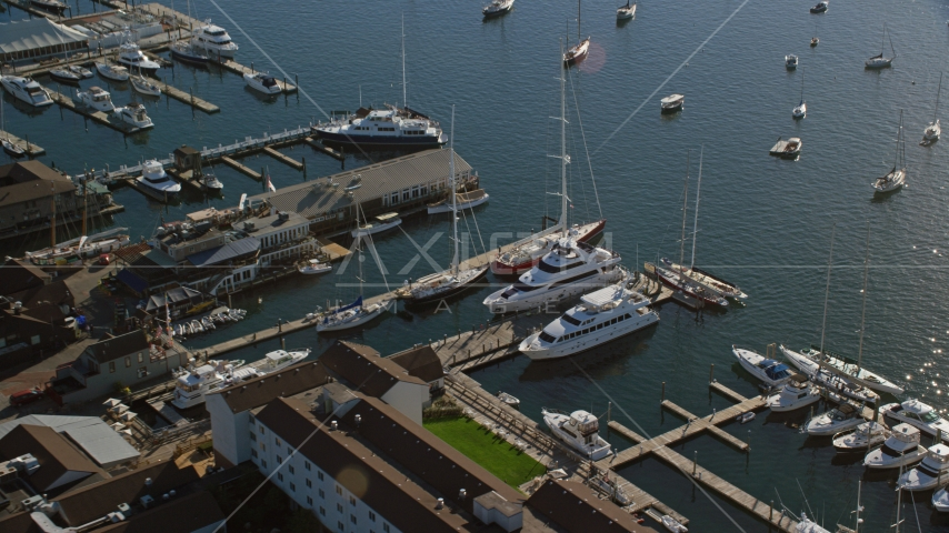 Yachts and sailboats docked at piers in Newport, Rhode Island Aerial Stock Photos | AX144_238.0000000