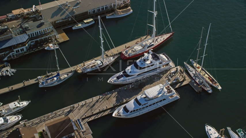 Two yachts docked near sailboats at piers in Newport, Rhode Island Aerial Stock Photos | AX144_238.0000119