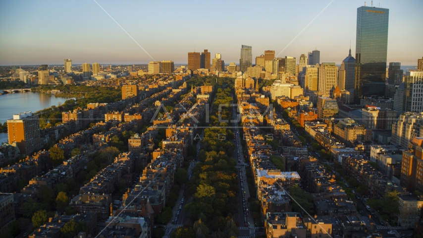 Back Bay brownstones and Downtown Boston skyscrapers, Massachusetts, sunset Aerial Stock Photos | AX146_062.0000288F