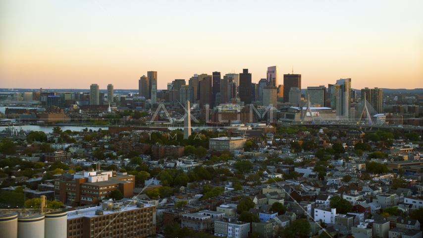 The Bunker Hill Monument and the Downtown Boston skyline, Charlestown, Massachusetts, sunset Aerial Stock Photos | AX146_094.0000191F