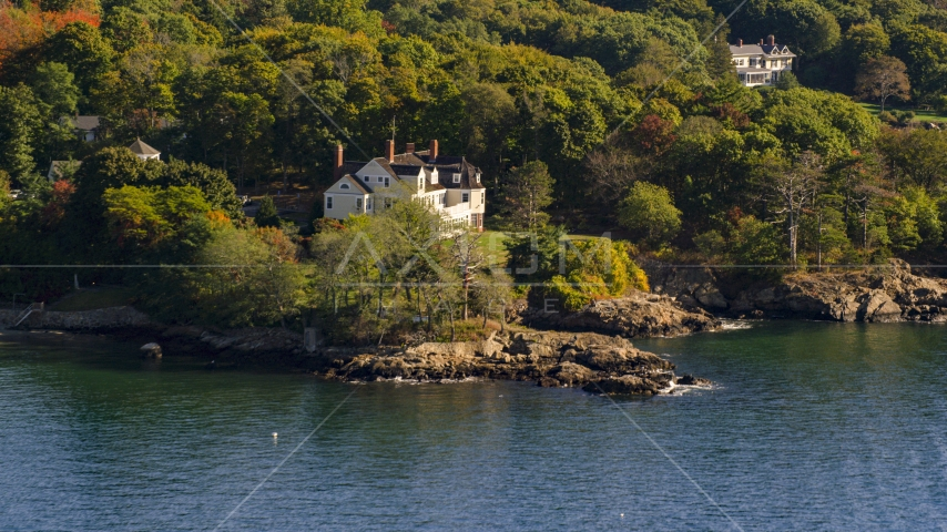 An oceanfront mansion among trees, autumn, Beverly, Massachusetts Aerial Stock Photos | AX147_055.0000017