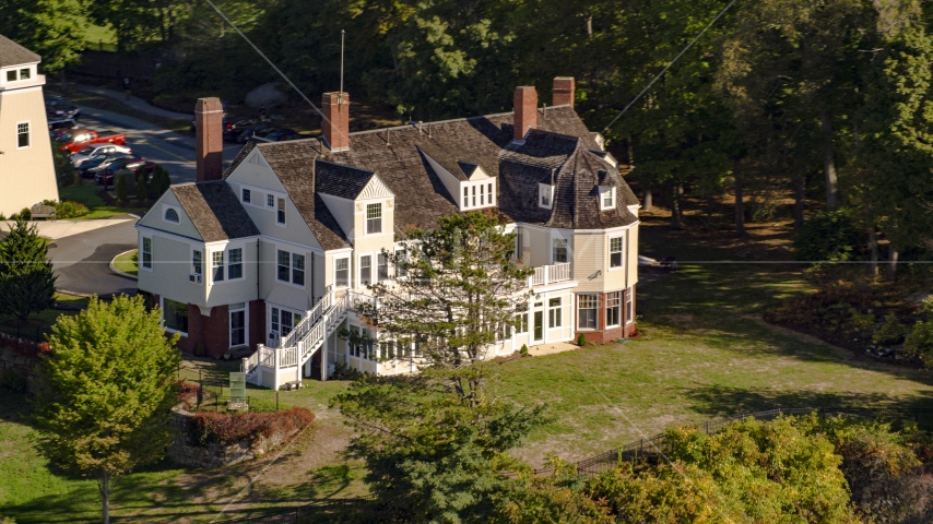 A spacious, oceanfront mansion among trees, autumn, Beverly, Massachusetts Aerial Stock Photos | AX147_055.0000283