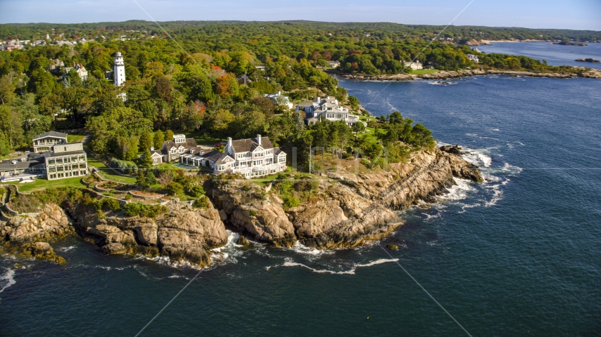 Oceanfront mansions and trees with fall foliage, Manchester-by-the-Sea, Massachusetts Aerial Stock Photos | AX147_063.0000000