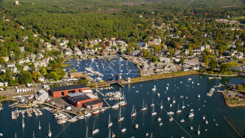 A harbor and coastal community surrounded by trees in autumn, Manchester-by-the-Sea, Massachusetts Aerial Stock Photos | AX147_068.0000000