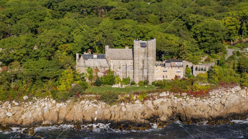 Hammond Castle on a rocky coastline, Gloucester, Massachusetts Aerial Stock Photo AX147_081.0000394 | Axiom Images