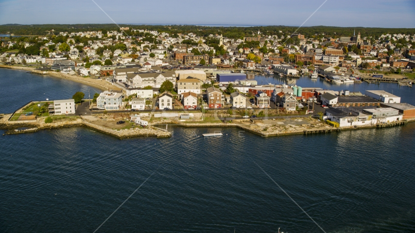 A coastal town with waterfront warehouses, Gloucester, Massachusetts Aerial Stock Photos | AX147_099.0000000