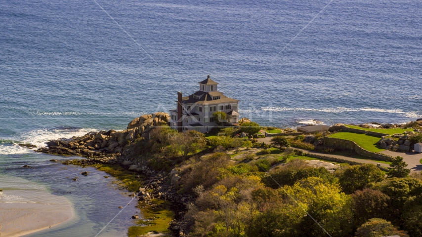 Oceanfront home on rocky shoreline, Gloucester, Massachusetts Aerial Stock Photos | AX147_107.0000030