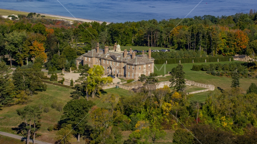 The Great House at Crane Estate and Castle Hill surrounding by trees in autumn, Ipswich, Massachusetts Aerial Stock Photos | AX147_141.0000156