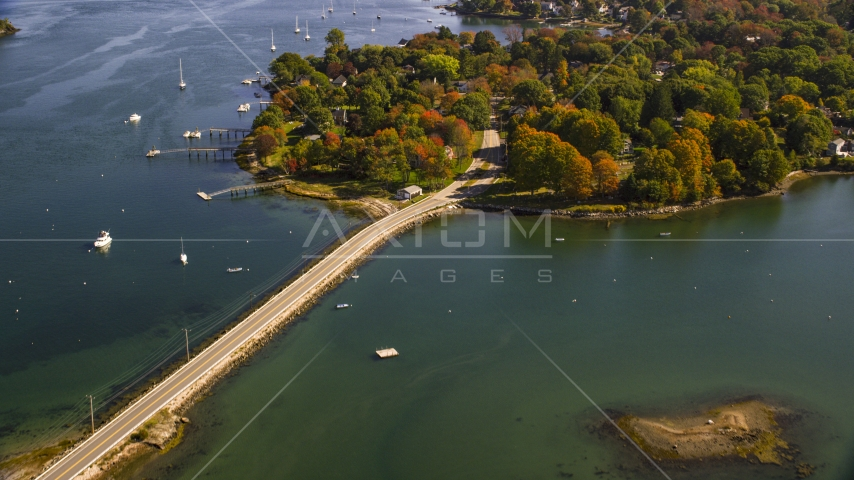 A small bridge leading to coastal homes in autumn, New Castle, New Hampshire Aerial Stock Photos | AX147_189.0000000