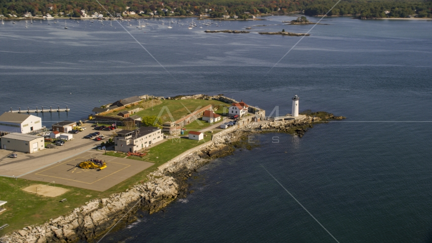 Lighthouse and fort on New Castle Island in autumn, New Castle, New Hampshire Aerial Stock Photo AX147_192.0000271 | Axiom Images