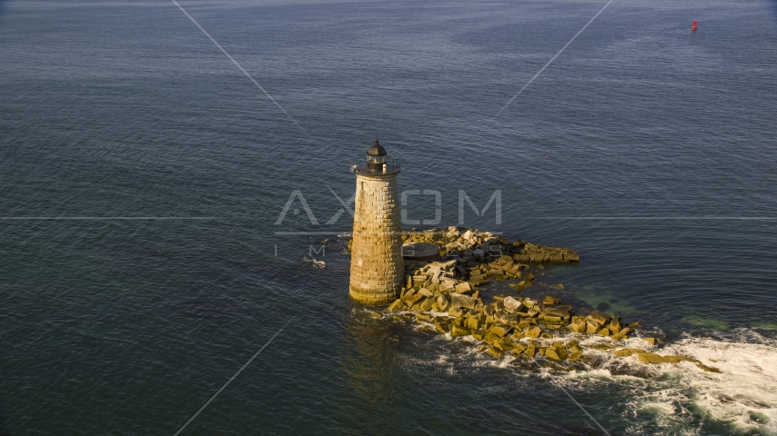 A lighthouse in the water by rocky shore, Kittery, Maine Aerial Stock Photos | AX147_196.0000000