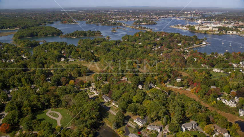 Autumn trees in a coastal town, New Castle, Portsmouth, New Hampshire Aerial Stock Photos | AX147_199.0000000