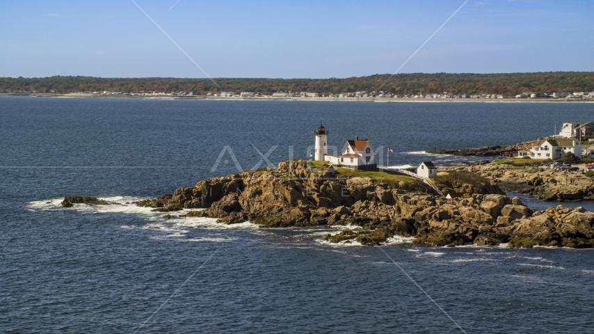 Cape Neddick Light, coastal town in background, autumn, York, Maine Aerial Stock Photos   AX147_238.0000188