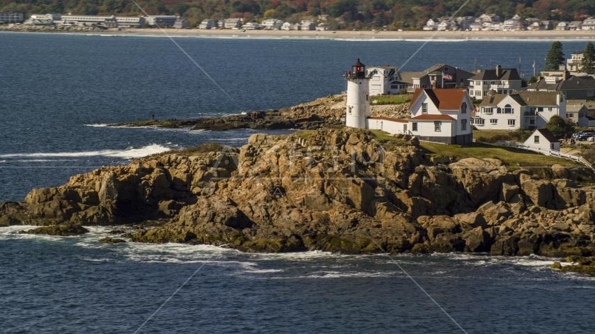Cape Neddick Light on a rocky shore, autumn, York, Maine Aerial Stock Photos   AX147_239.0000000