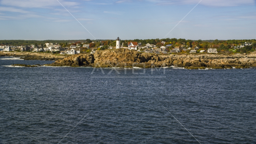 The Cape Neddick Light with the town behind it in autumn, York, Maine Aerial Stock Photos   AX147_240.0000000