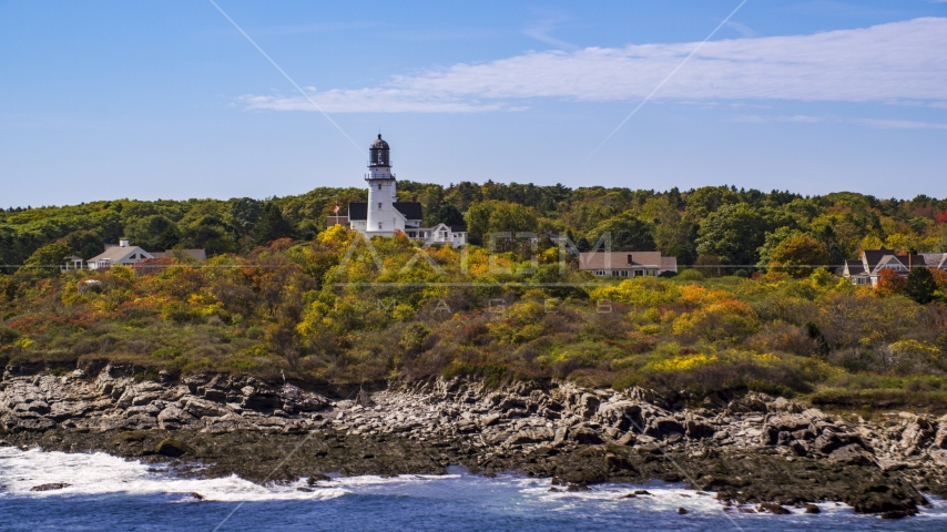 Cape Elizabeth Light seen from the rocky shore, autumn, Cape Elizabeth, Maine Aerial Stock Photo AX147_306.0000287 | Axiom Images