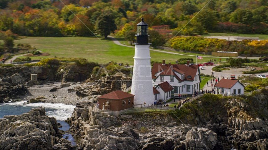 The Portland Head Light on the rocky coast in autumn, Cape Elizabeth, Maine Aerial Stock Photos | AX147_313.0000000