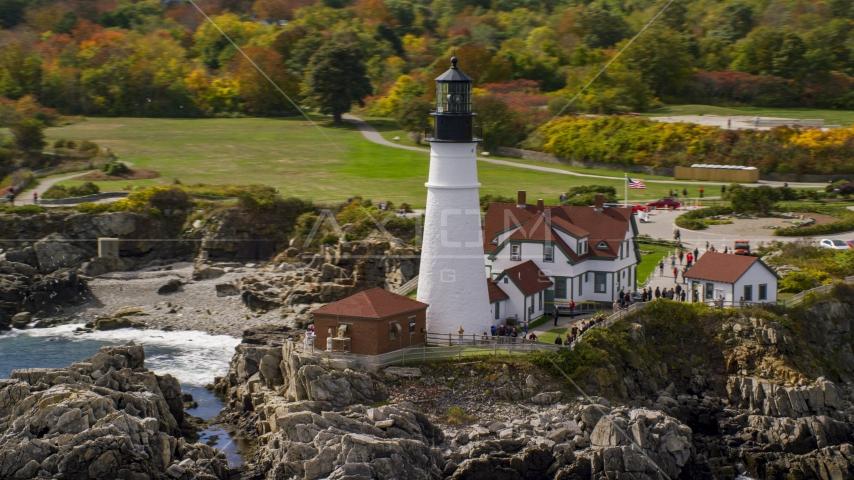 The Portland Head Light on the rocky coast in autumn, Cape Elizabeth, Maine Aerial Stock Photos | AX147_313.0000000