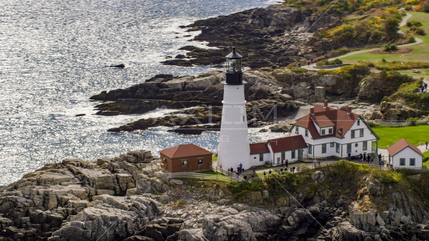 Portland Head Light on a rugged coastline in Cape Elizabeth, Maine Aerial Stock Photo AX147_313.0000156 | Axiom Images