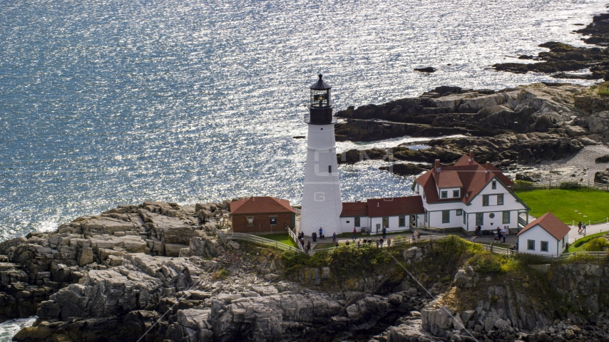 Portland Head Light overlooking the ocean on a rocky coast, Cape Elizabeth, Maine Aerial Stock Photos | AX147_313.0000268